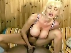 Legend Dolly Buster Rides On A Big Fat Cock